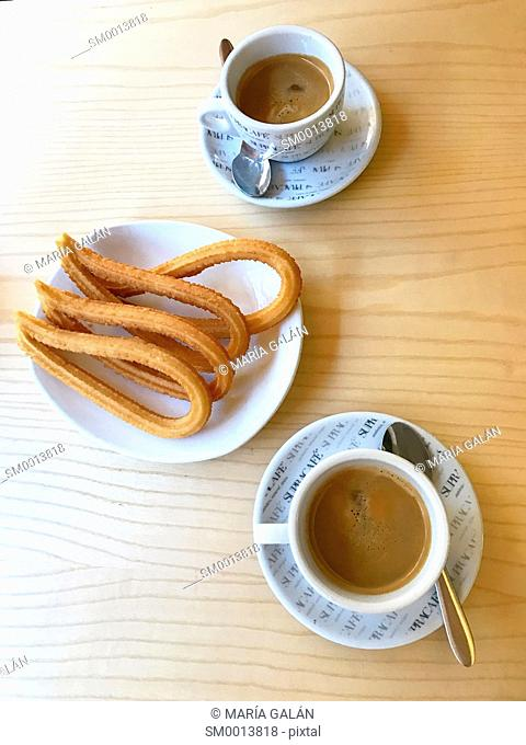 Two cups of coffee with churros. Madrid, Spain