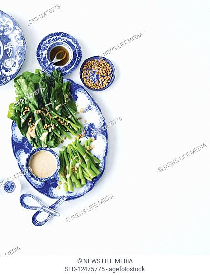 Gai Lan with pine nut sauce and sesame