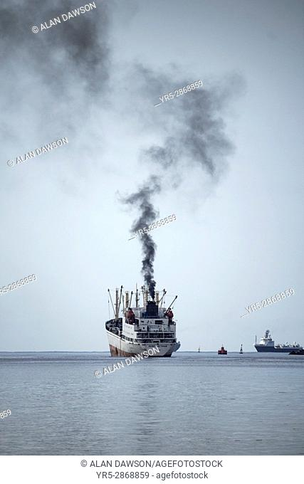 Black smoke from funnel of large Russian trawler leaving Las Palmas port on Gran Canaria, Canary Islands, Spain