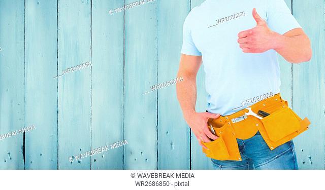 Carpenter against blue wood panel