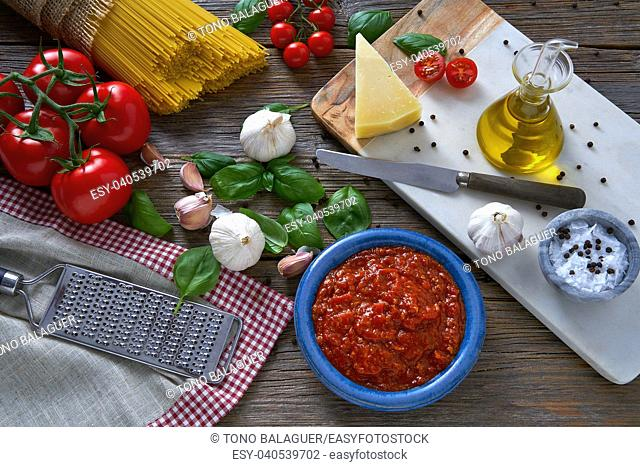 Italian Spaghetti pasta food with cheese tomato garlic basil on wood