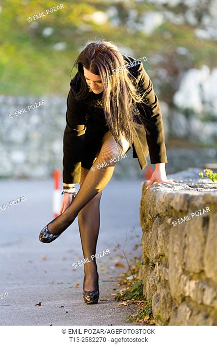Tight high-heels fanciful young woman