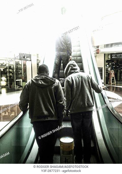 Hoodie on an escalator