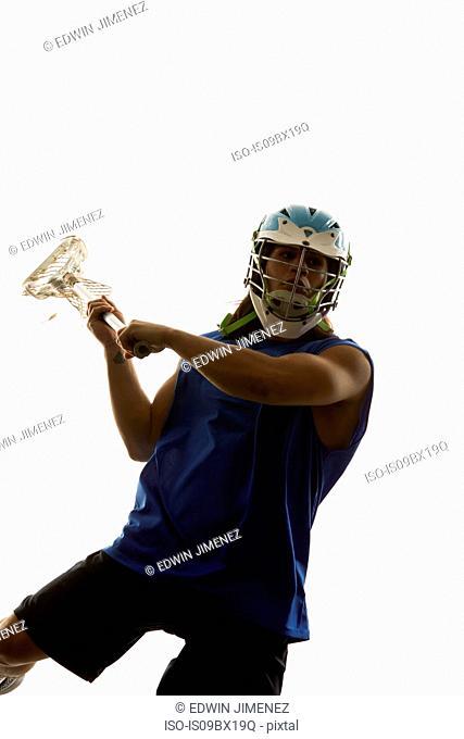 Man modelling lacrosse helmet and stick