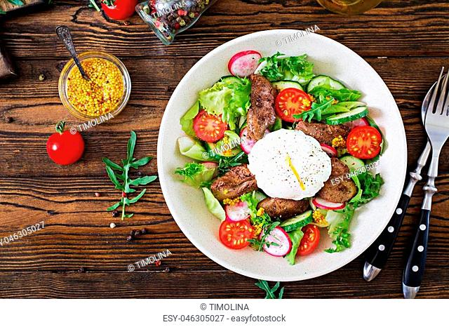 Warm salad from chicken liver, radish, cucumber, tomato and egg poached. Healthy food. Dietary menu. Top view. Flat lay