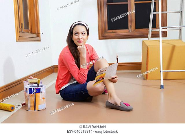 Young woman getting her house painted