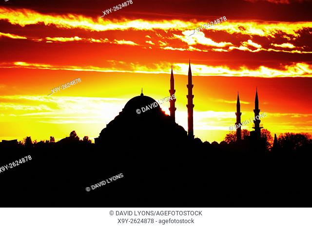 Sunset behind Suleymaniye Mosque and minarets, central Istanbul, Turkey. Ottoman imperial Islamic dates from 1550 seen from N. E