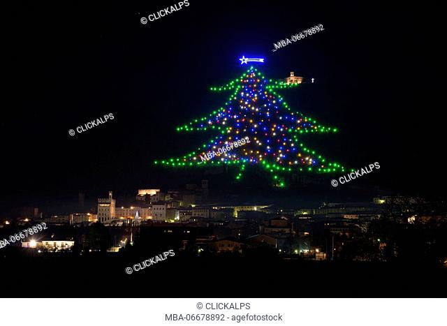 The biggest Christmas tree of the world, drawn with lights on the mount Ingino, Gubbio, Umbria, Italy