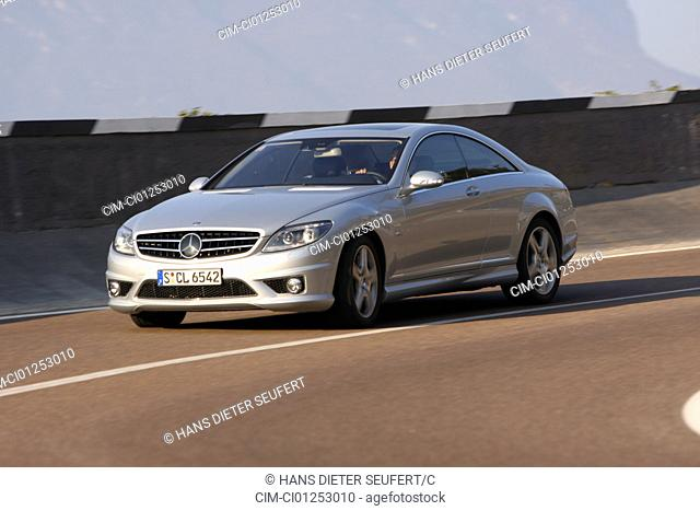 Mercedes CL 65 AMG, model year 2008-, silver, driving, diagonal from the front, frontal view, country road