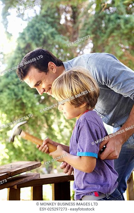 Father And Son Building Tree House Together