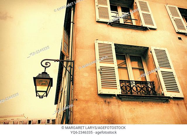 Old, Parisian historic house with an old street lamp in vintage style