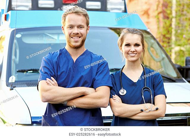 Portrait Of Medical Staff Standing In Front Of Ambulance