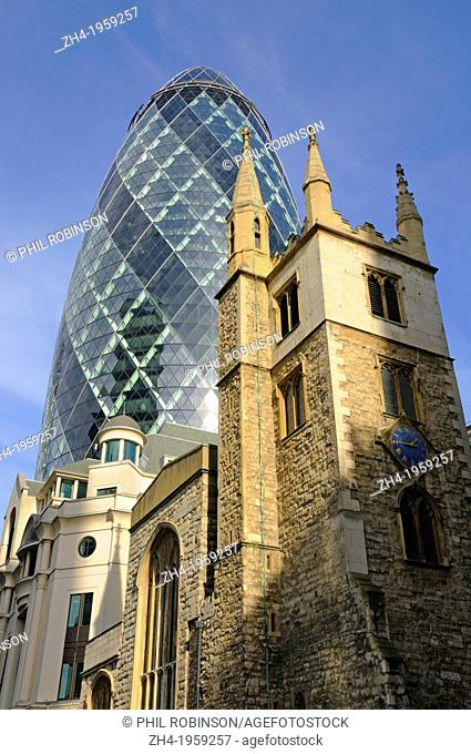 London, England, UK. Church of St Andrew Undershaft - 15thC tower and 'The Gherkin' (30 St Mary Axe) behind