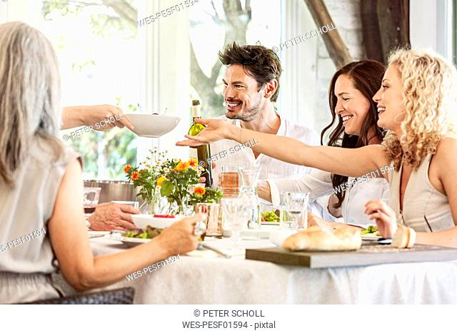 HapǬpy family celebrating together, clinking glasses