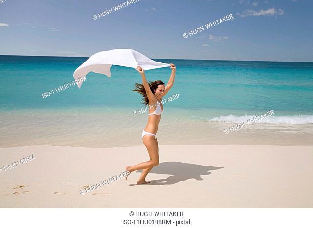 Woman Running on Tropical Beach