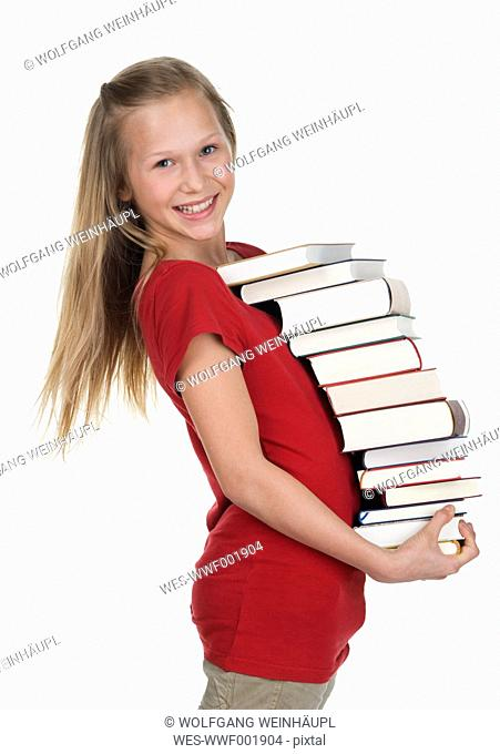 Girl carrying stack of books against white background