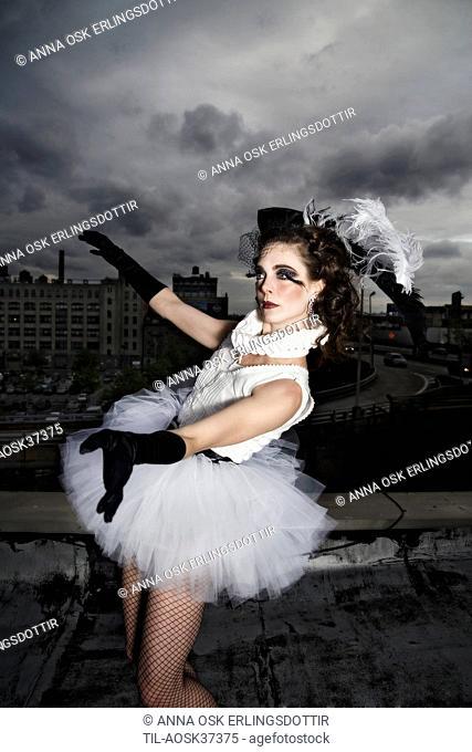 Lone female figure in ballet costume under sky