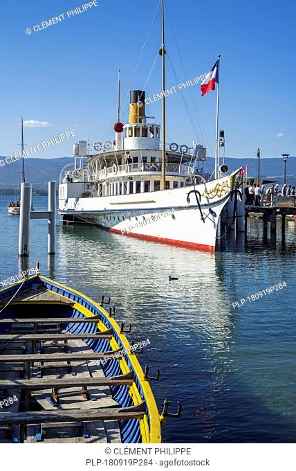Swiss historic Belle Epoque paddle steamboat Savoie in the old port at Yvoire along Lake Geneva / lac Léman, Haute-Savoie, France