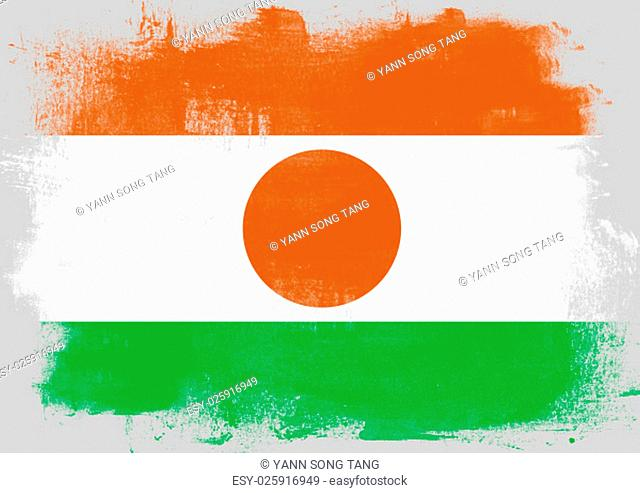 Flag of Niger painted with brush on solid background