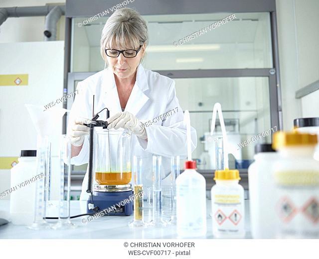 Female chemist working in chemical laboratory