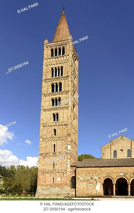 huge bell tower of ancient Romanesque abbey, shot in bright spring sun light at Pomposa, Ferrara, Italy