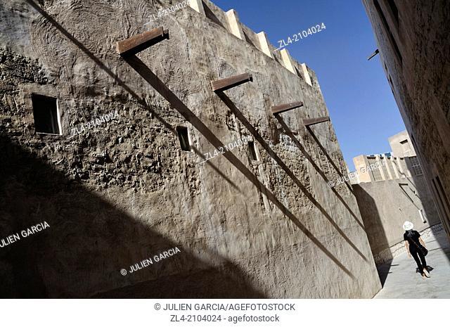 Traditional narrow street. United Arab Emirates, UAE, Dubai, Al Fahidi Historical Neighbourhood. Model Released