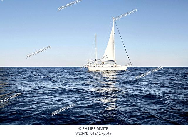 Man on his sailing boat on the sea