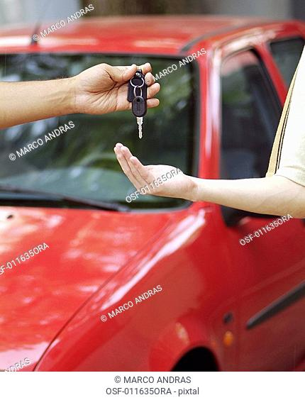 one person lending the carkey to other