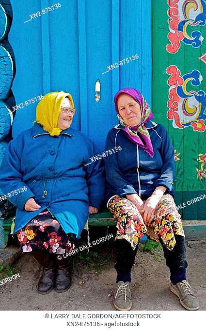 Russia. Tarbagatai Villlage of Old Believers of original Russian Orthodox. Two residents taking the sun