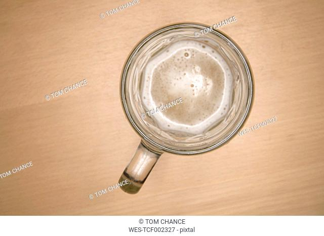 Empty beer mug on table, close up