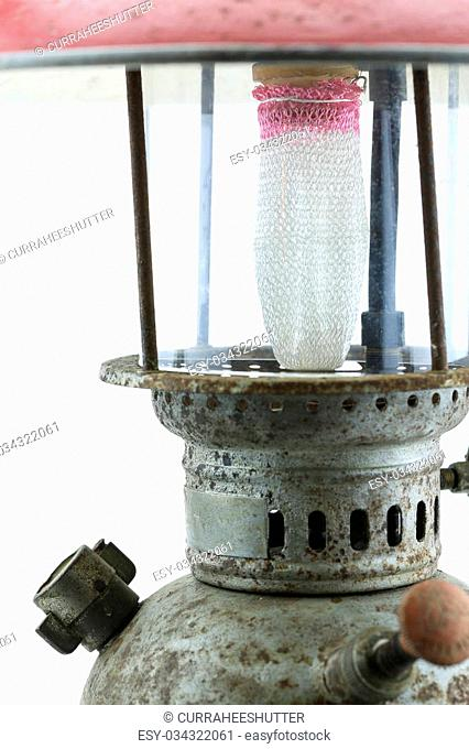 Old or vintage hurricane lamp on white background, Material corrosion of lamp material