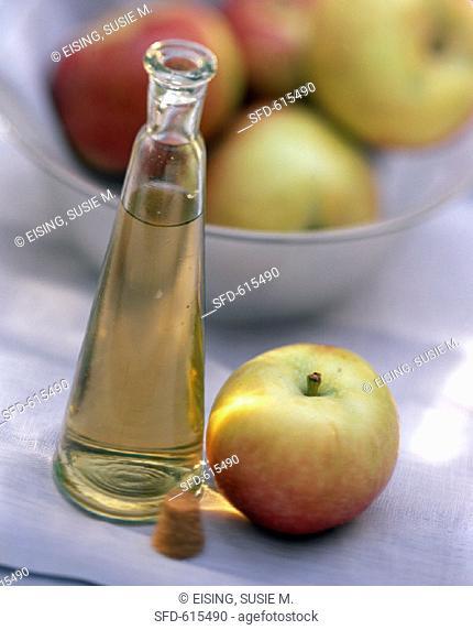 Apple Vinegar in a Bottle with an Apple