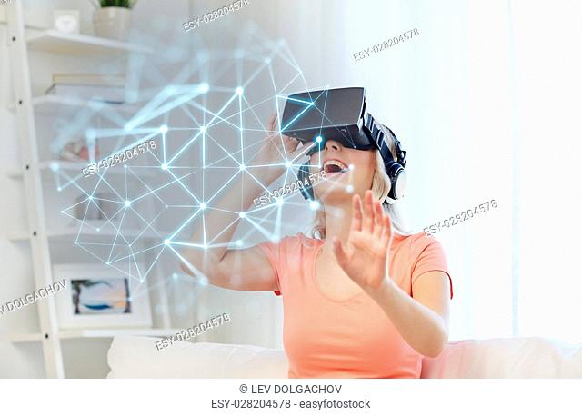 technology, augmented reality, entertainment and people concept - happy young woman in virtual headset or 3d glasses and headphones playing game at home and low...