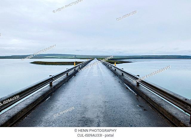 Straight road bridge crossing water, Saudarkrokur, Iceland