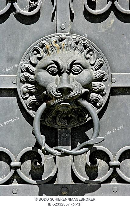 Lion head as door knocker on the iron doors of the Bavarian National Museum in Munich, Bavaria, Germany, Europe