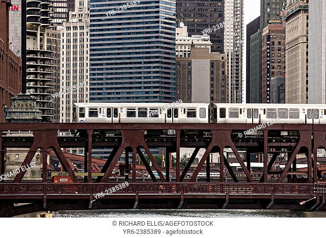 Elevated train known as the L crossing the Chicago River on the North Wells Street bridge in Chicago, IL