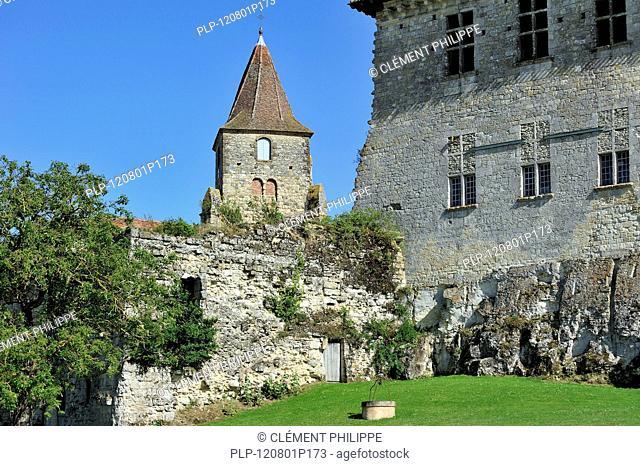 Church tower and the medieval castle Château de Lavardens in the Midi-Pyrénées, Pyrenees, France