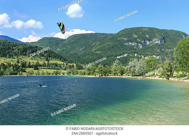 Tourist paragliding on lake Bohinj a famous destination not far from lake Bled, in Slovenia