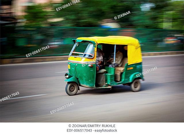 Indian auto (autorickshaw) taxi in the street. Motion blur. India