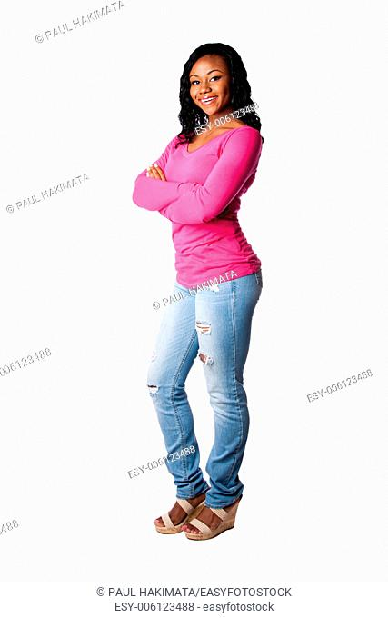 Beautiful happy smiling college student girl standing with arms crossed, isolated