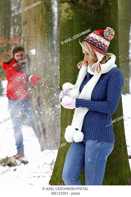 young couple in winterly landscape