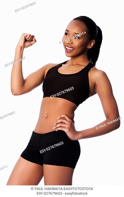 Beautiful healthy fit happy smiling celebrating black asian woman workout fitness and toned body
