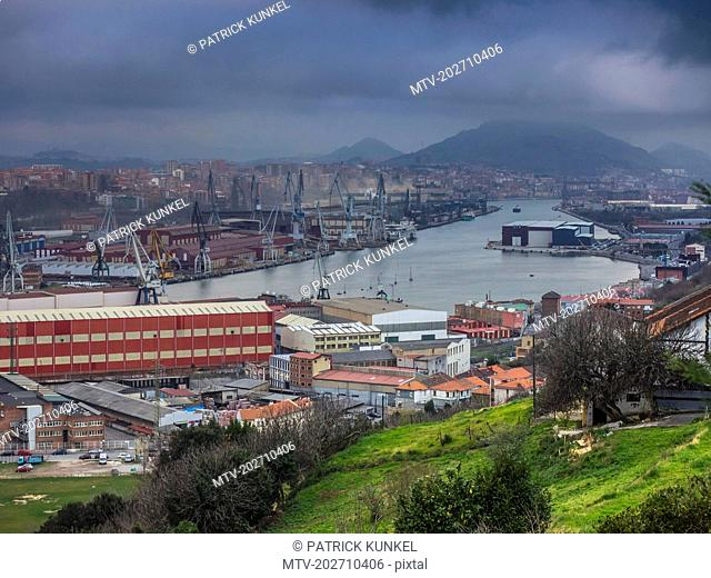 Wharf, river and stormy weather at Ria of Bilbao