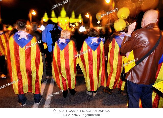 Political demonstration for the independence of Catalonia with Independence flags. Maria Cristina avenue. 2014. The National Palace in the background