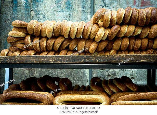 Shelf of a Jewish peddler breads on a street in Jerusalem, Israel
