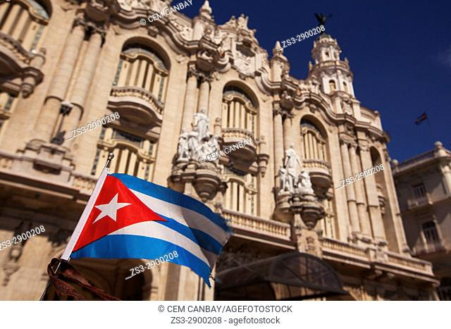 Cuban flag on a car with the Gran Teatro-Grand Theatre building at the background, in Central Havana, La Habana, Cuba, West Indies, Central America