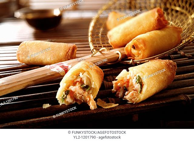 Traditional chinese prawn spring rolls being cooked