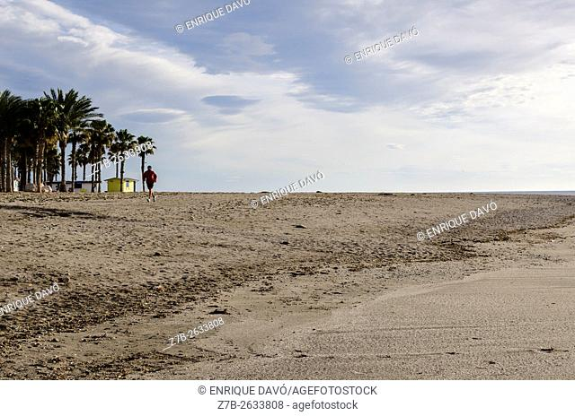 A down runner view in the beach of Carboneras village, Almeria province, SpainA