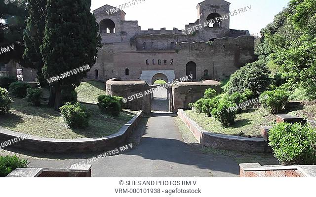 Daylight, LS, TILT up on Porta Asinaria. It is a part of the Aurelian walls of Rome. The gate was built between 270 and 273 AD and was dominated by two...