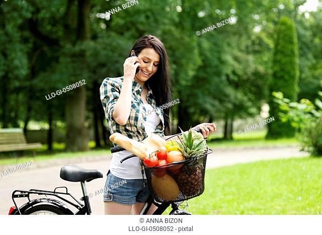 Young woman on the phone, Debica, Poland